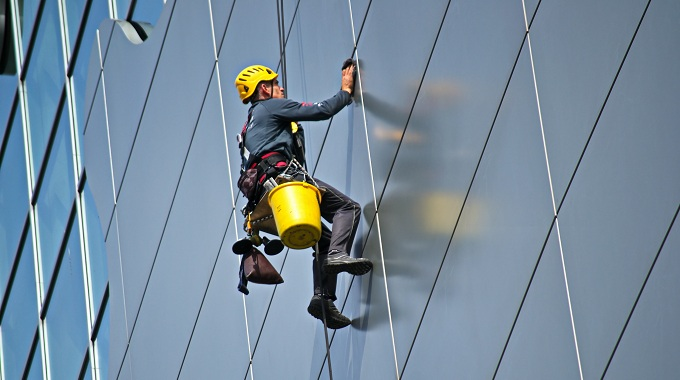man-cleaning-the-glass-of-building-756883